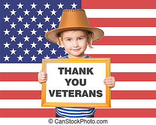 Little Funny girl in striped shirt with blackboard. Text THANK YOU VETERANS. On background of American flag