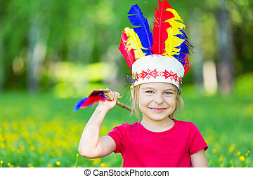 little funny girl playing native american