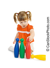 Little funny girl with toys