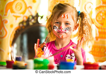 Little funny kid drawing paint with paint of face