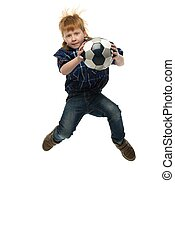 Little funny redhead boy with soccer ball jumping