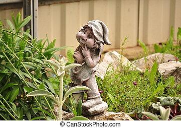 Little garden gnome in the rockery