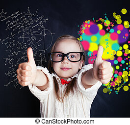 Little genius girl on chalk board in classroom with symbol of right and left hemispheres of the brain - science and arts elements