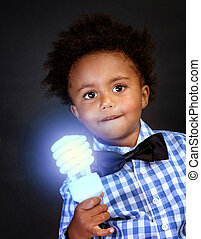 Little genius with illuminated lamp in hand isolated on ...