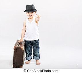 Little gentleman with huge suitcase