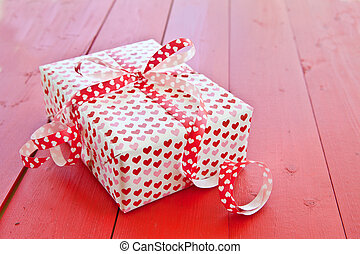 Little gift box with hearts