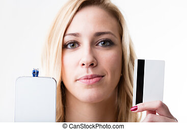 little gift packet on a smartphone and a girl with a credit card