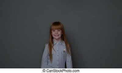 Little ginger girl quickly coming close up to the camera,...