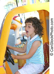 little gird playing driving toy car