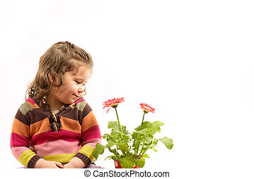 Little girl admiring flowers