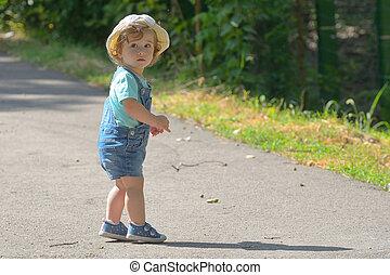 Little girl alone on street