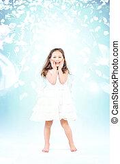 Little girl among flying rose petals