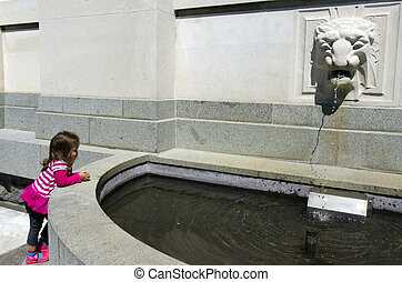 Little girl and a Fountain