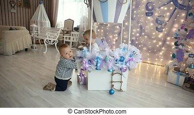 Little girl and boy floor christmas tree