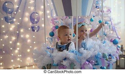 Little girl and boy fun christmas tree