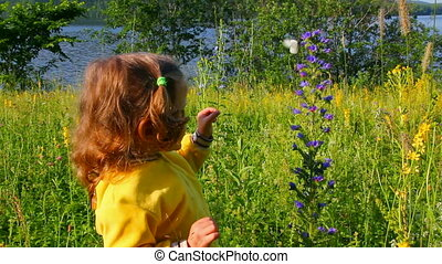 little girl and butterfly on flower