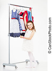 Little girl and clothes hangers shopping
