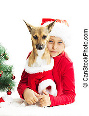 little girl and dog in Christmas costume on white background