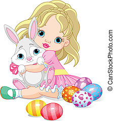 Little girl and Easter bunny - Cute little girl hugging...