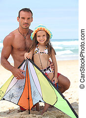 Little girl and father at the beach
