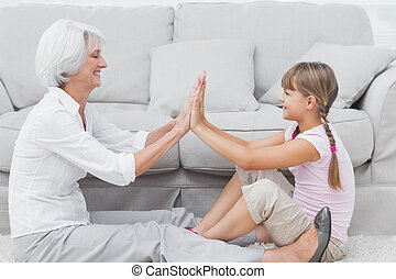 Little girl and grandmother playing together