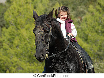 little girl and her black horse