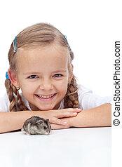 Little girl and her hamster