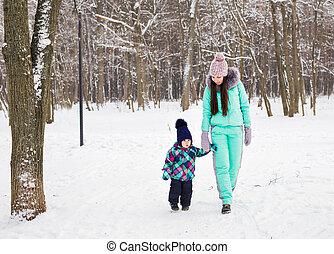 Little girl and her mom having fun on a winter day