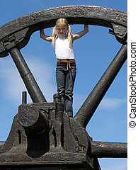 Little girl and large wheel