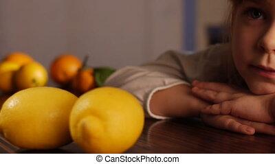 little girl and lemons