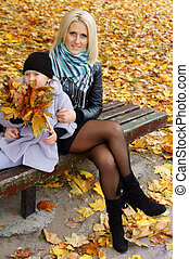 little girl and mom with leaves