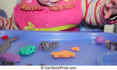 Little girl and mother play with plasticine, Full HD