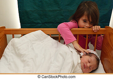 little girl and newborn sister