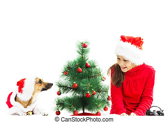 little girl and red dog dressed as Santa Claus