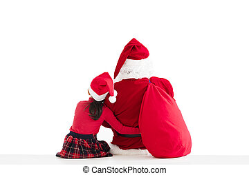little girl and Santa Claus pointing to white background