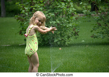 Little Girl and Sprinkler
