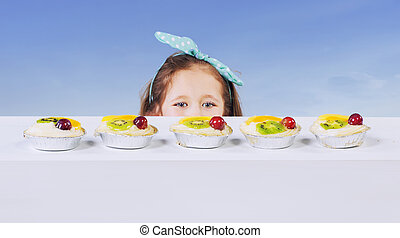 Little girl and the fruit cake
