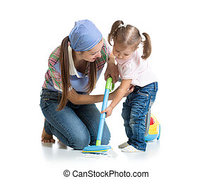 Little girl and woman with vacuum cleaner