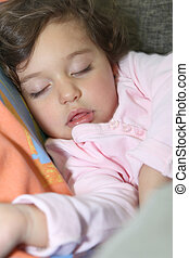 Little girl asleep on sofa