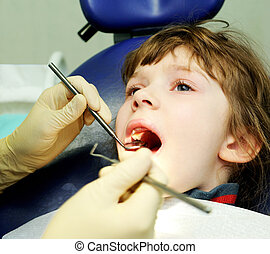 little girl at a dentist examination and teeth medical treatment