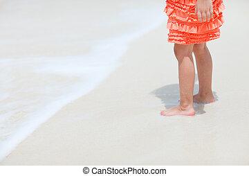 Little girl at beach close up