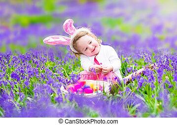 Little girl at easter egg hunt - Adorable toddler girl with...