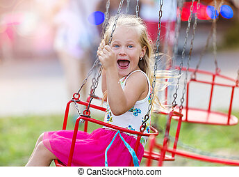 Little girl at fun fair - Cute little girl having fun at fun...