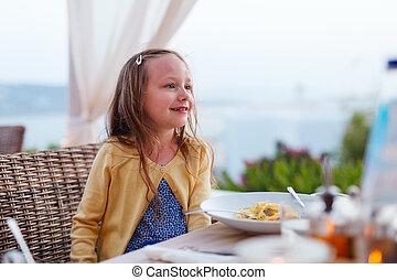 Little girl at restaurant