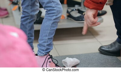 Little girl at shoe store