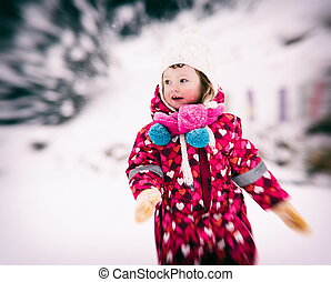 little girl at snowy winter day - portrait of happy smiling ...
