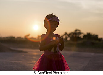 Little girl at sunset
