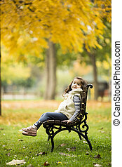 Little girl at the bench