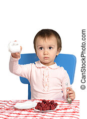 Little girl at the breakfast table