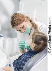 Little girl at the dentist checkup